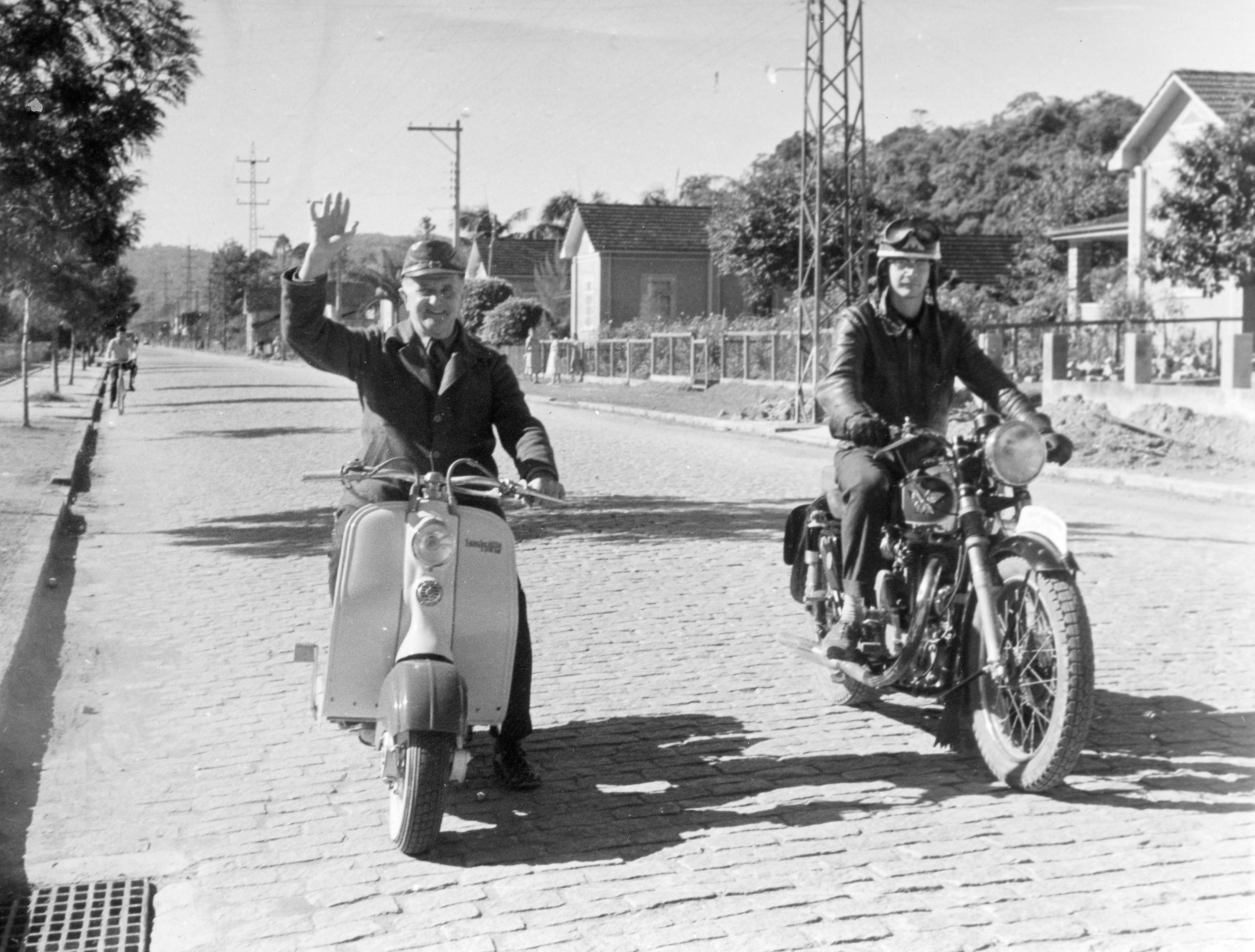 """28.8.1958. Myself and one of my grandsons taken in a main street of Joinville Est. S.C. I'm sending you this so you do not forget me. As you see, I have bought another Lambretta for cruising around in. Greetings from the bicycle city. Jacob Bachmann snr. in Brusque, Brazil."""