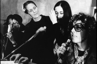 four women in front of microphones