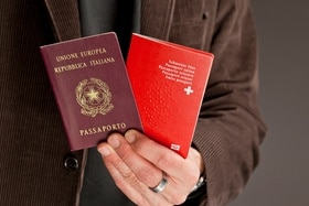 A man holds two passports
