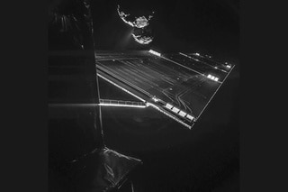 one of Rosetta s solar panels, with the comet in the background.