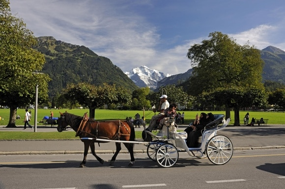 Tourists take ride in horse drawn cart in Interlaken