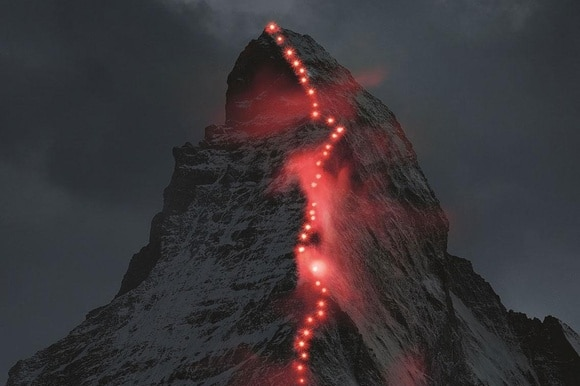 Lamps illuminate the path of the first ascent on the famous Matterhorn mountain, in Zermatt, Switzerland.