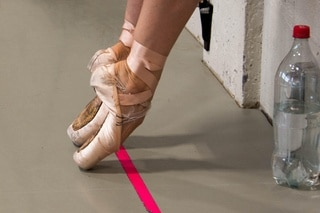 a dancer flexing her feet on her tip toes