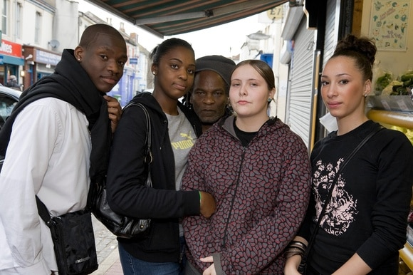 A racially mixed group of young people in the streets