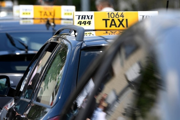 taxis go slow in Zurich to protest against uber