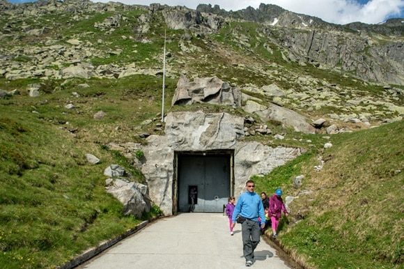 The entrance to a military bunker with visitors in the foreground