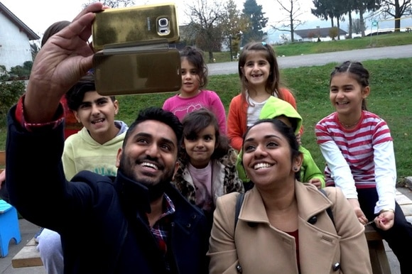 Tama, her brother, and the child asylum seekers at a refugee centre take a selfie