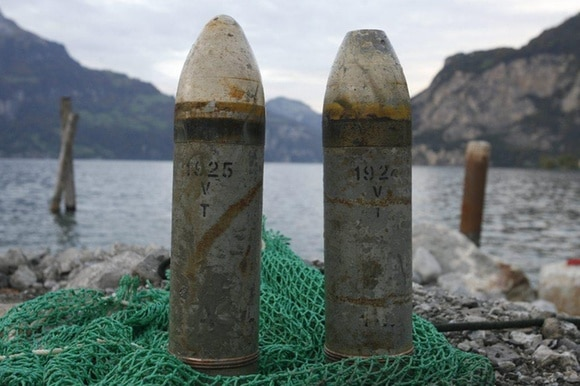 Two artillery shells in a net by the lakeshore