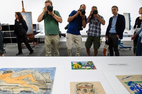 Photographers take pictures of artwork from the Gurlitt collection in Bern