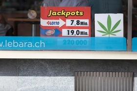 A poster in the shop window advertises the sale of legal cannabis