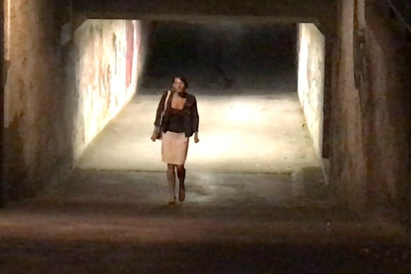 Lady walking through lonely underpass