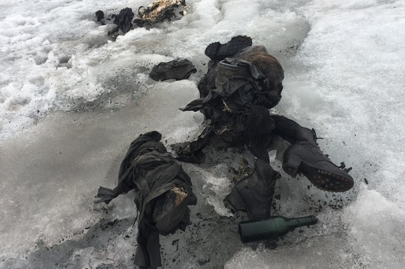 mummified remains of two people in glacier