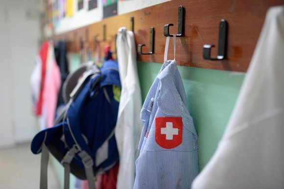 Schoolbag and a shirt of with a Swiss flag in a Swiss school