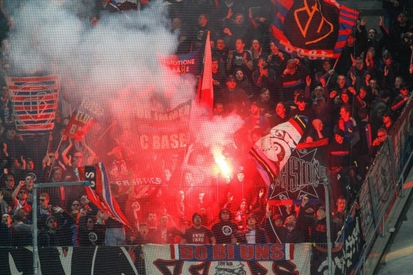 Football fans with flares