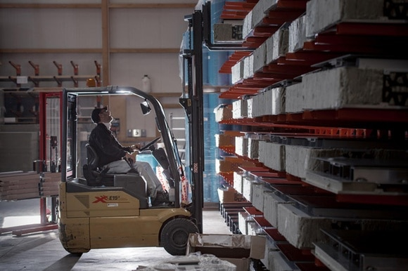 Man on forklift truck in a Swiss factory