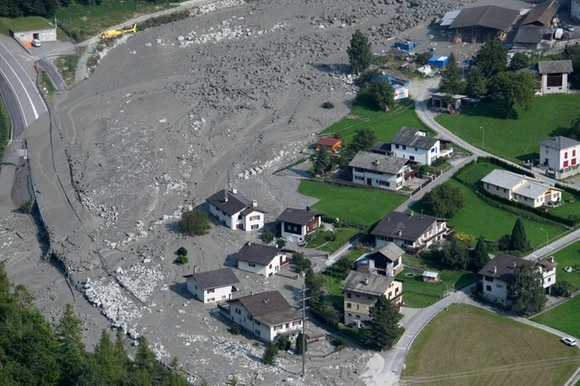 Mud rushes towards the village after another eruption, in Bondo, Graubuenden in South Switzerland, on Friday, August 25, 2017.