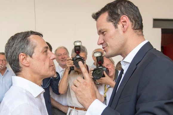 ignazio cassis and pierre maudet face off