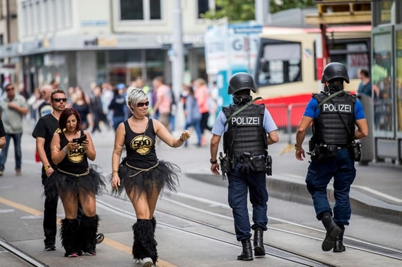 Police on patrol during the annual techno parade in Zurich