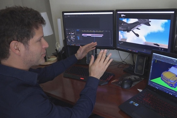 Action designer shows screens where he is making special effects