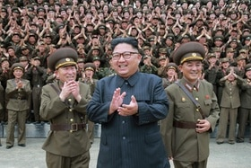 North Korean leader Kim Jong-un acknowledges a welcome from military from military officers during a visit
