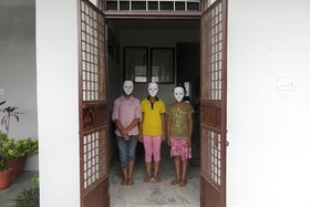 three children wearing masks