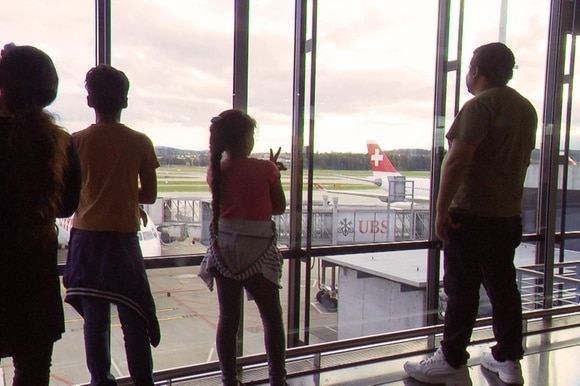 Family waiting to board plane