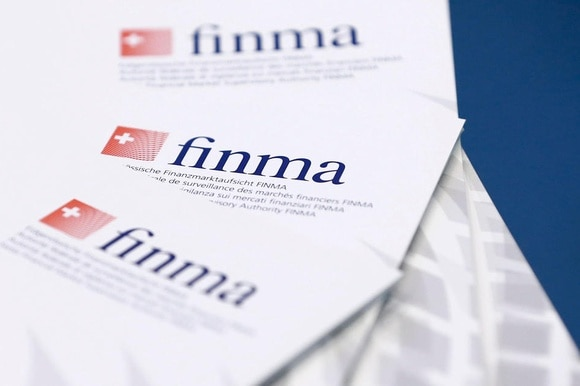 Paper on a table bears the Finma logo