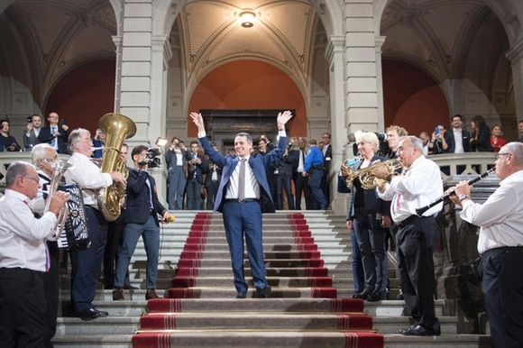 Ignazio Cassis and a brass band