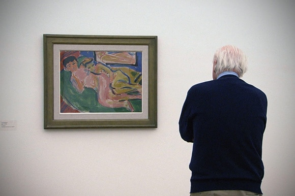 Eberhard Kornfeld looking at painting