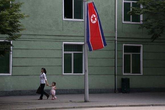 woman, child, and north korean flag