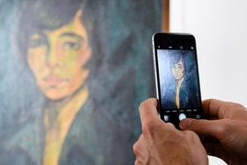 A painting is photographed by a smartphone