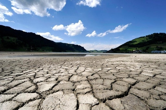 Ground-level view of dried mud on the banks of the Sihlsee, a lake in the Swiss canton Schwyz