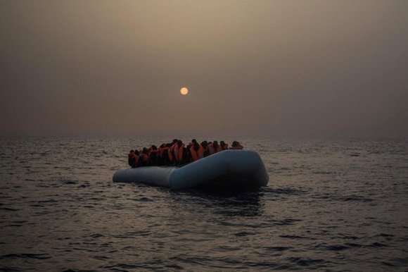 people in overloaded boat