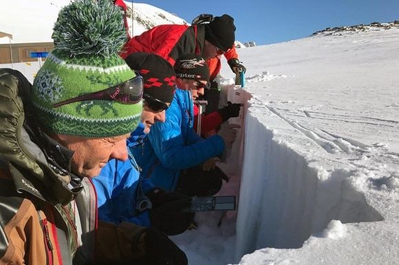 Avalanche observers learn how to check the profile of the snowpack