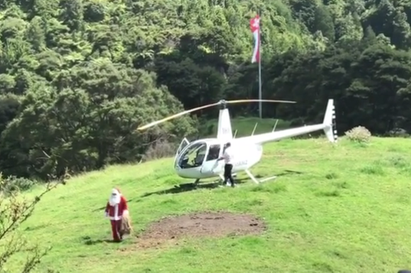 Santa Claus arrives by helicopter in New Zealand