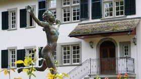 Exterior shot of C.G. Jung Institute, with statue in foreground