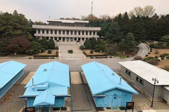 Three blue barracks - known as Conference Row - connect North Korea (visible across the street) and the South.