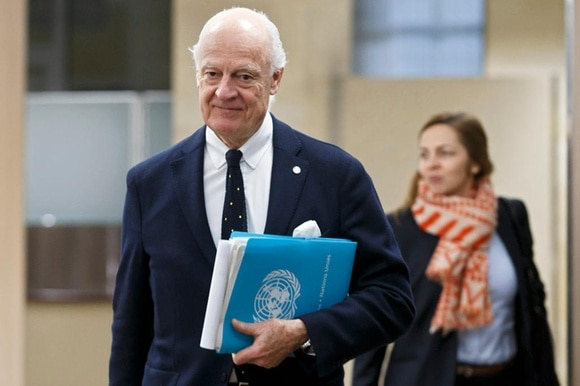 diplomat with UN file followed by woman
