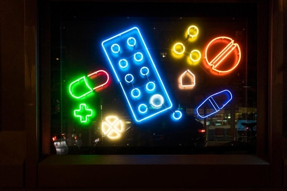 Fluorescent tubes formed into pills and medicines in a shop window