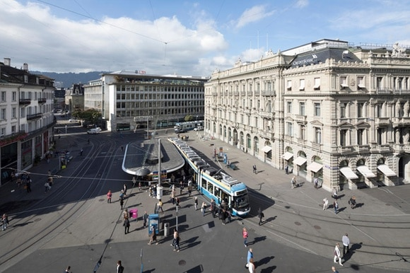A tram stops in the midst of banks in Zurich s Paradeplatz