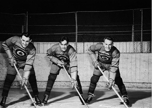 Members of the Canadian Ice Hockey Team: Ab Renaud, Ted Hibberd, and Reg Schroeter.