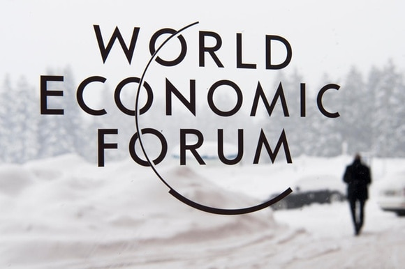 WEF logo on a screen in front of winter landscape
