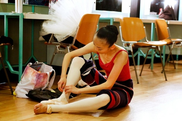A young ballet dancer prepare for the International Ballet Competition