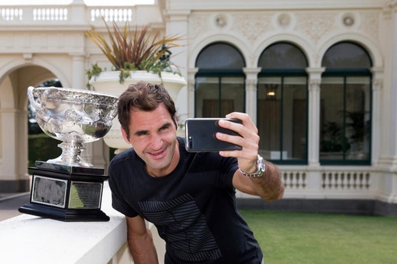 Roger Federer with his latest Australian Open trophy