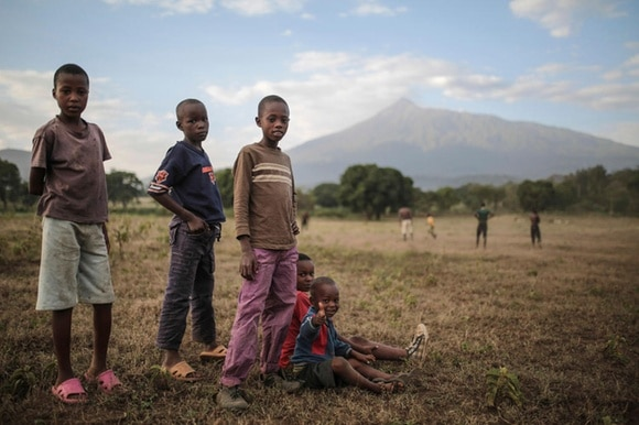 Children in Tanzania pose for a photo after a football game in Arusha, eastern Tanzania.