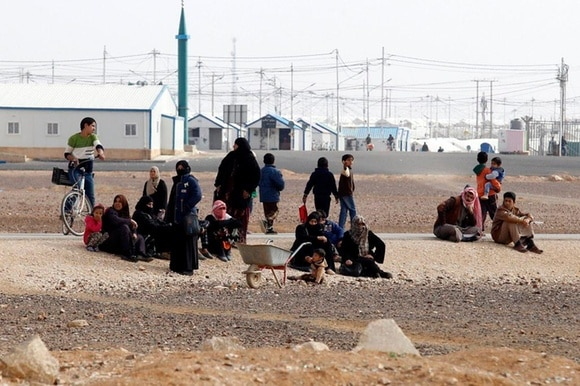 Syrian refugees gather at Azraq refugees camp in Azraq, Jordan, 29 January 2018.