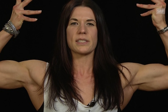 Anita flexing muscles