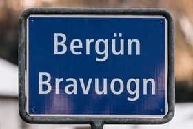 The place name sign of the village of Berguen in the Albula Region of the Canton of Grisons, Switzerland