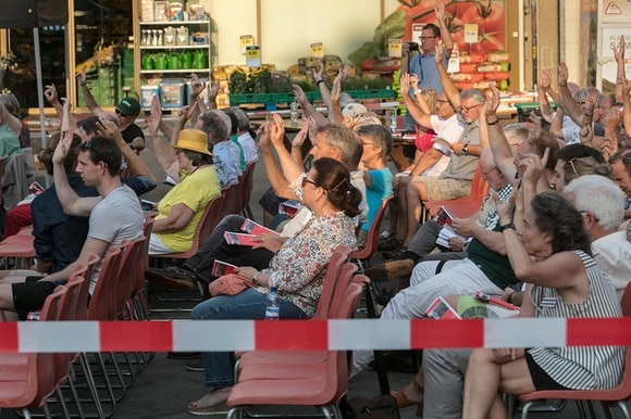 Citizens taking part in an open-air local assembly