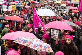 Some of the 8,000 protesters hold signs and umbrellas at the Women s March in the city of Zurich on Saturday, March 18, 2017.